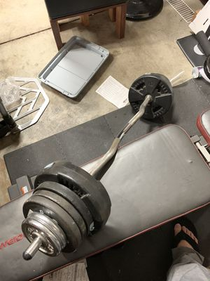 Starter Home Gym Incline Decline Bench Curl Bar Weight Plates Door Pull Up Bar for Sale in West Covina, CA