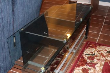 Glass Television Stand, Great Condition for Sale in Waldorf,  MD