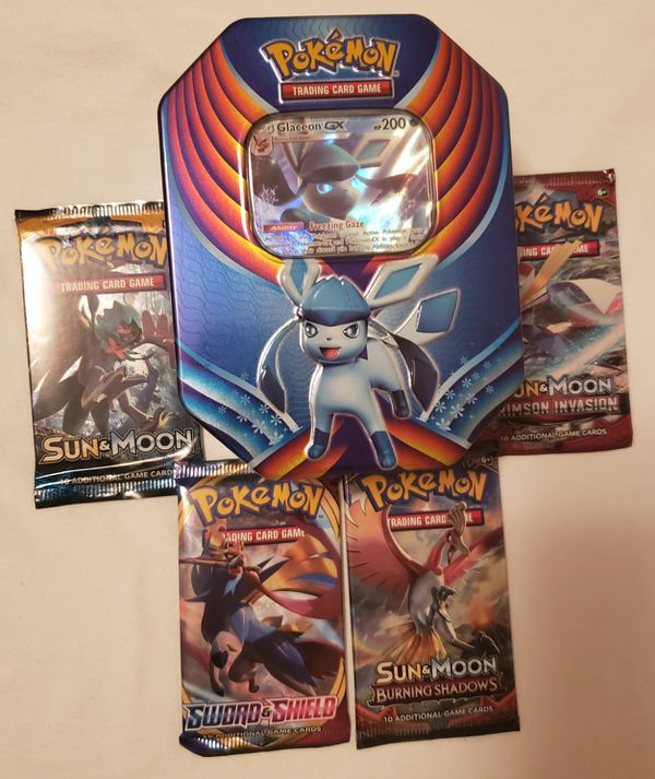 Pokemon tins with 4 brand new booster packs