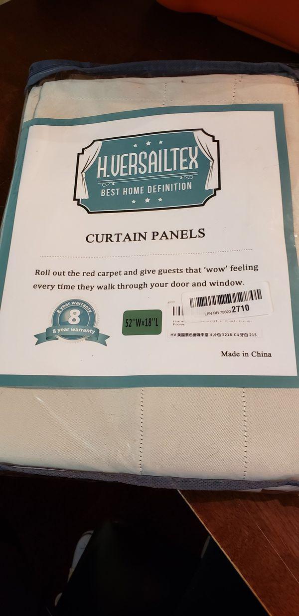 Cream color curtain panels