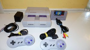 Super nintendo system with two controllers & Super mario World game for Sale in Dallas, TX