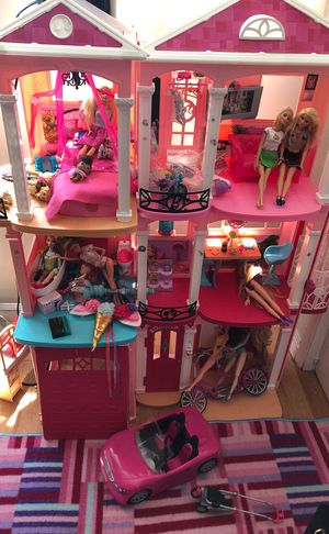Barbie dream house with dolls and Barbie car for Sale in Oakland, CA