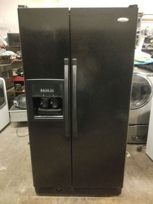 Whirlpool side-by-side refrigerator with water and ice to the door. for Sale in Dallas, TX