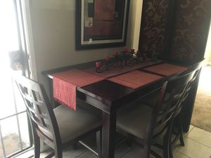 Dark wood dinning room table seats six for Sale in Carson, CA