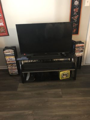 42 inch sharp with tv stand for Sale in Leesburg, VA