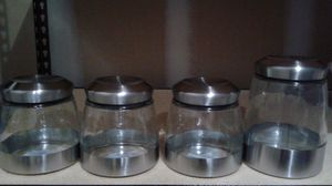 Four glass canisters new never used for Sale in Apex, NC