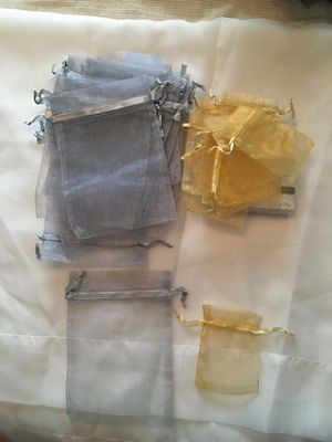 Organza bags gold 34 (4in. Tall x 3in. Wide)....Grey 23 (7in. Tall x 5in. Wide. ) Brand new never used. for Sale in Oak Lawn, IL