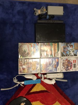OBO Wii U Console Only With All Attachments, 2 Controllers Plus 2 Chucks, 8 games ( Monitor Option Available ) for Sale in Escondido, CA
