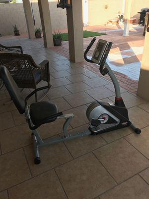 Exercise equipment-Bike, Ab lounger, maxi Climber punching bag for Sale in Phoenix, AZ