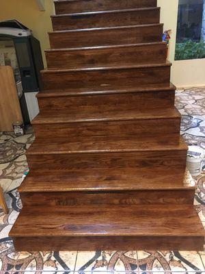 Se asen trabajos de pisos de madera glue down laminado vinyl tile y escaleras for Sale in Irving, TX