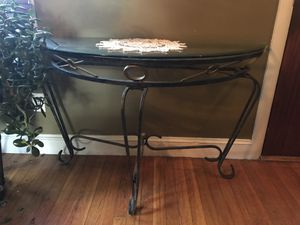 Console cast iron table - 48W 18D 27 1/2 H Top glass half moon shape. for Sale in Boston, MA