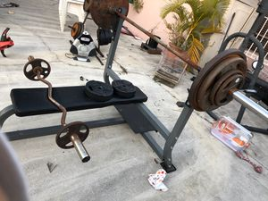 250 pds of weight with entire bench and bars for Sale in Miami, FL