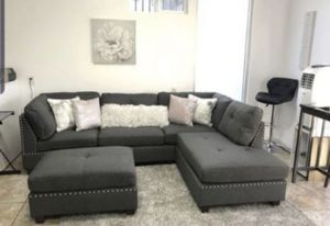 New in boxes grey sectional sofa with ottoman/ reversible chaise for Sale in Norwalk, CA