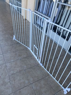 Dog gate super wide walk through door with little door build in. 76 inches wide adjustable 38 inches tall. It's new for Sale in Los Angeles, CA