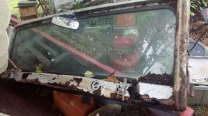 Windshield from 1979 jeep. frame is not any good but has lock downs and windshield motor and linkage all comes together. also has rear view mirror. for Sale in Aurora, OH