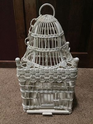 White wicker bird cage. Working order with slide out tray for easy clean up. Never used for keeping a bird just for decoration. Beautiful addition to for Sale in Bel Air, MD