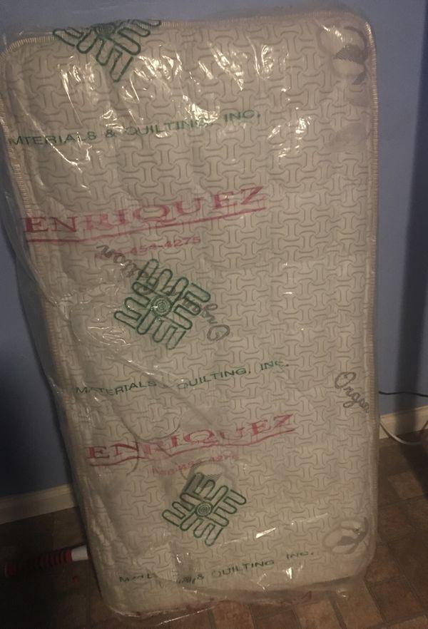 Kids Bed mattress new in Plastic asking 35$ Obo