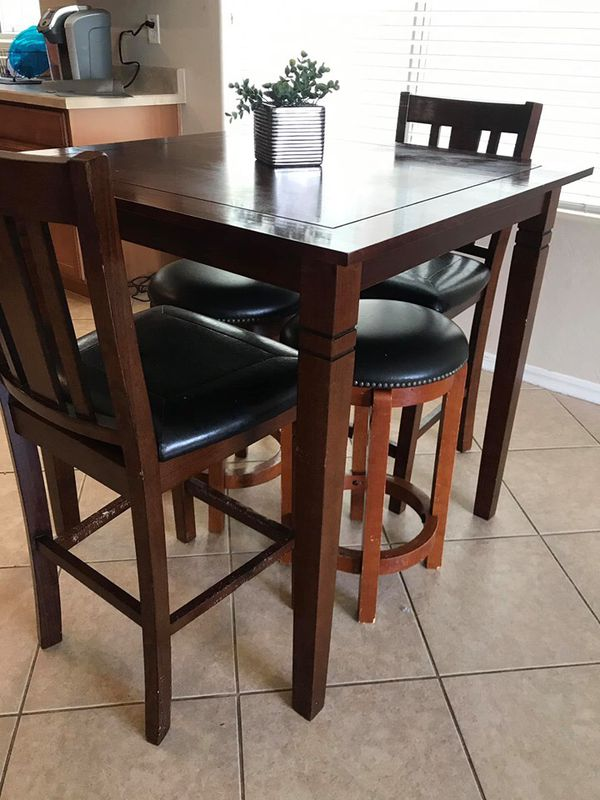 Small High Top Kitchen Table. 2 Chairs And 2 Stools. Has
