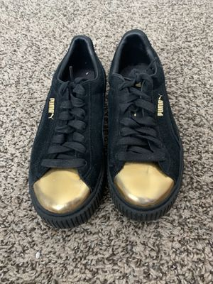 Black and gold pumas size 7 for Sale in Arvada, CO