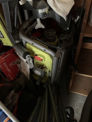 Ryobi table saw with guide and wheels missing a couple of screws to hold heels on only for Sale in Los Angeles, CA