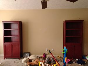 Two matching red bookshelves with doors and storage at bottom for Sale in Lexington, KY