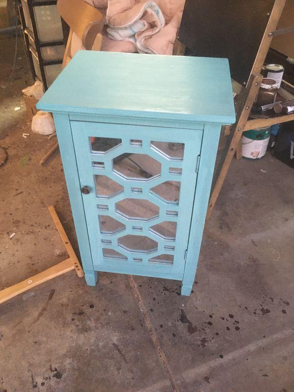 Tiffany blue mirrored cabinet