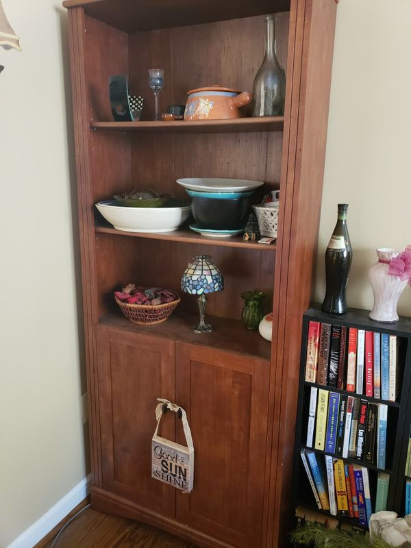Shelf with cabinets below