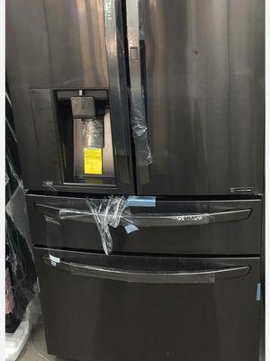 LG Electronics 29.7 cu. ft. French Door Refrigerator with Door-in-Door in Black Stainless Steel for Sale in Houston, TX