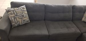 Moving price 2 months old couch and microwave going with it gift for the buyer for Sale in Jacksonville, FL