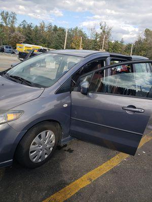 Mazda 2007,la vendo x que compre otra esta en perfecto estado y tiene 105 millas ,esta en oferta $4,500 le caben de 6 a 7 pasajeros mini ven.. for Sale in Waltham, MA