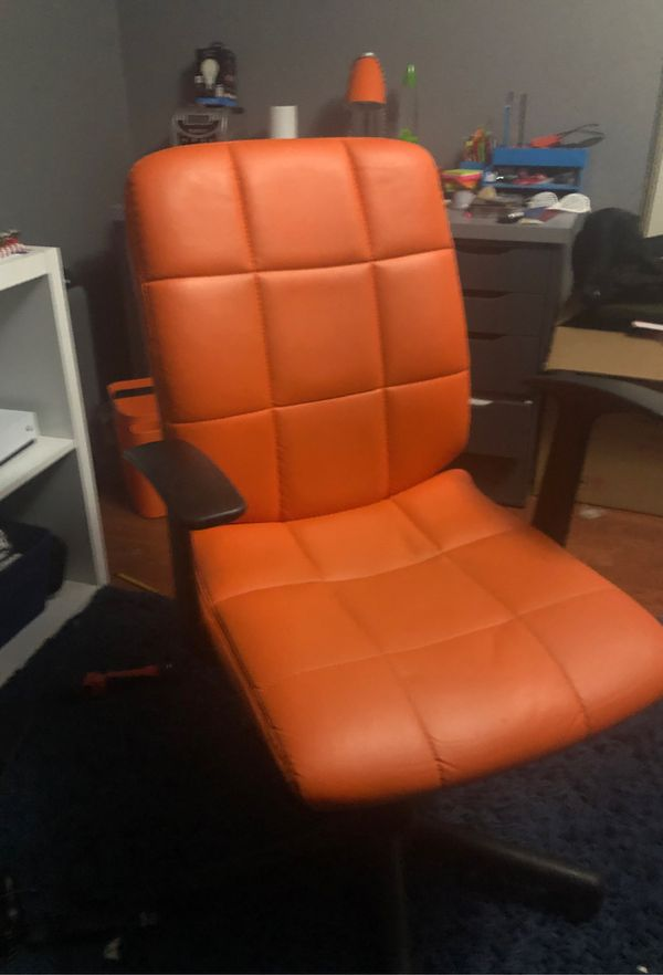 Comfortable ergonomic orange leather adjustable chair.