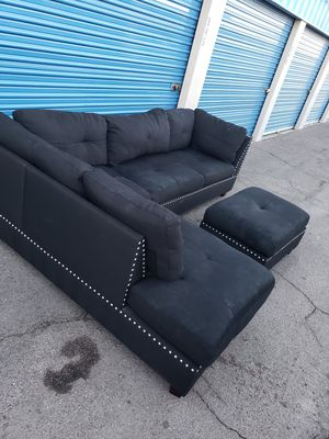 Comfortable sectional couch with ottoman, dark gray for Sale in Glendale, AZ