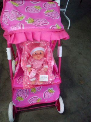 $20 mini baby with pacifier and blanket in car seat in stroller located in Palmdale California we ship out for Sale in Palmdale, CA