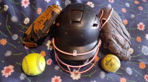2 softball gloves helmet and 2 softballs hardly used for Sale in Hemet, CA