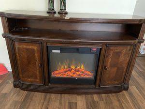 Electric Fireplace/Tv stand 72 inch Real wood not press wood very heavy and sturdy. Can heat an entire room easily for Sale in Stone Mountain, GA