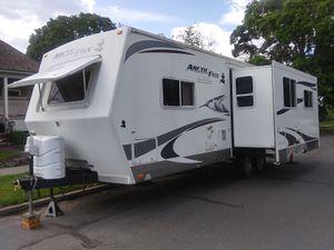 27ft 2011 silver fox pop out travel trailer for Sale in Spokane, WA