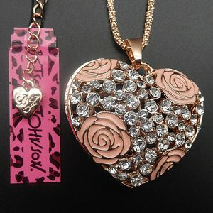 Betsey johnson 3 d rhinestone filigree heart with enamel roses on a gold chain for Sale in Northfield, OH