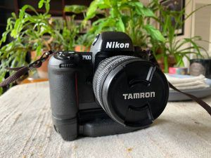 Nikon F100 SLR film camera with battery pack and extras for Sale in Tacoma, WA