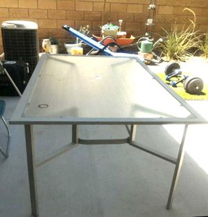 Metal glass top outdoor table. $30.00 for Sale in Henderson, NV