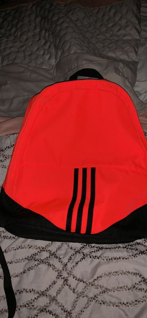 Adidas orange and black backpack for Sale in Frisco, TX
