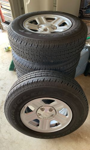 Jeep rims and tires brand new!! 225-75-16 stock wheels for Sale in Glendora, CA