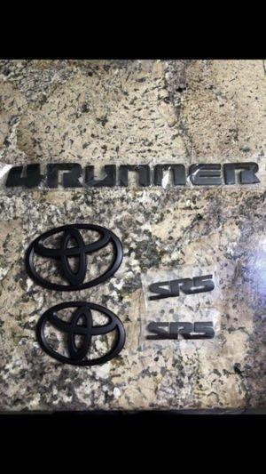 Toyota 4Runner Blackout Emblem Overlay Set PT948-89180-02. Black 5 Piece Emblem Overlay Set. 2018-2019 for Sale in Riverside, CA