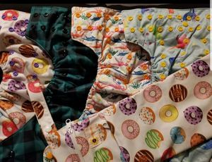 4 BNIP Girls cloth diapers with Wet Bag for Sale in Arlington, TX
