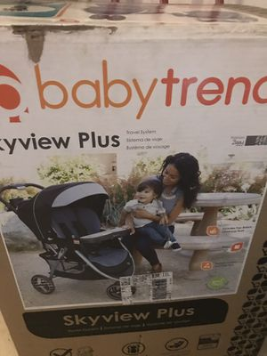 Sky view plus 3wheel scroller with car seat all in one brand knew for Sale in New Orleans, LA