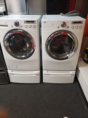 white LG washer and dryer set with pedestal for Sale in Baltimore, MD