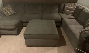 Grey sectional couch and storage ottoman for Sale in Redmond, WA