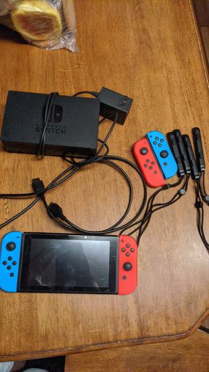 Nintendo switch with 4 contolers with 128gb memory for Sale in Los Angeles, CA