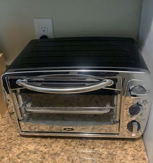 Oyster toaster oven, bought brand new for 120$ . I've literally never used it, it's taking up too much space. Asking $50 and will deliver for free for Sale in Portage, MI