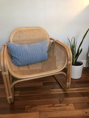 As new condition urban outfitters Rattan armchair for Sale in Denver, CO