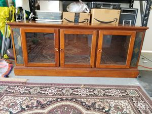 Solid wood media cabinet/entertainment center. for Sale in Bakersfield, CA